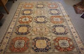Turkish Herekeh Rug, Decorated with six rows of three Geometric Medallions on a Beige ground,
