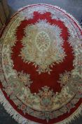 Chinese Style Rug, Decorated with Floral Medallions and Motifs on a Red ground, 290cm x 190cm