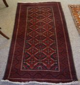Turkish Rug, Decorated with Geometric Medallions on a Red ground, 168cm x 93cm