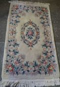 Chinese Style Rug, Decorated with Floral Motifs on a Cream ground, 180cm x 94cm