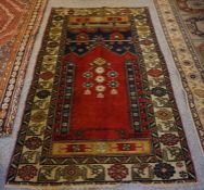 Old Turkish Rug, Decorated with Geometric and Floral Medallions on a Red ground, 175cm x 107cm