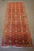 Hamadan Runner, Decorated with allover Geometric Medallions on a Red ground, 190cm x 76cm