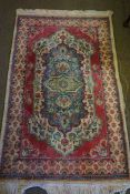 Persian Rug, Decorated with Geometric Motifs on a Pink ground, 158cm x 90cm
