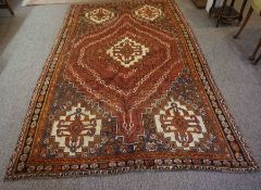 Qashqai Rug, Decorated with Geometric Medallions on a Red ground, 257cm x 161cmCondition reportMinor