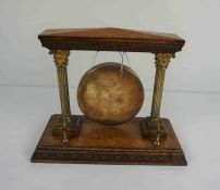 Oak and Brass Dinner Gong, 26cm high, 32.5cm wide, 15.5cm deepCondition reportThe age is