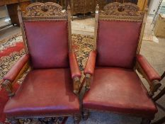 Pair of Late Victorian Carved Oak Parlour Armchairs, Upholstered in Later Red Rexine, Raised on
