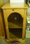Modern Pine Cabinet, Having a glazed door enclosing a shelved interior, 101cm high, 54cm wide,