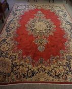 Persian Carpet, Decorated with Floral medallions on a red ground, 252cm x 362cm