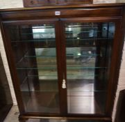 Modern Display Cabinet, Having two glazed doors, Enclosing glass shelves, Raised on Cabriole feet,