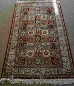 Indian Kashmir Rug, Decorated with ten rows of five Floral and Geometric Medallions on a Red ground,
