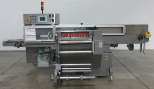 Used- IMA Model 3711U Automatic Overwrapping Machine For Cannabis Products