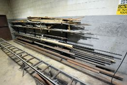 contents of cantilever wall rack containing black pipe, aluminum bar,