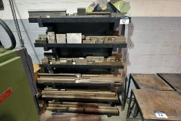 Contents of 6 tier cantilever wall rack containing assorted brake dies