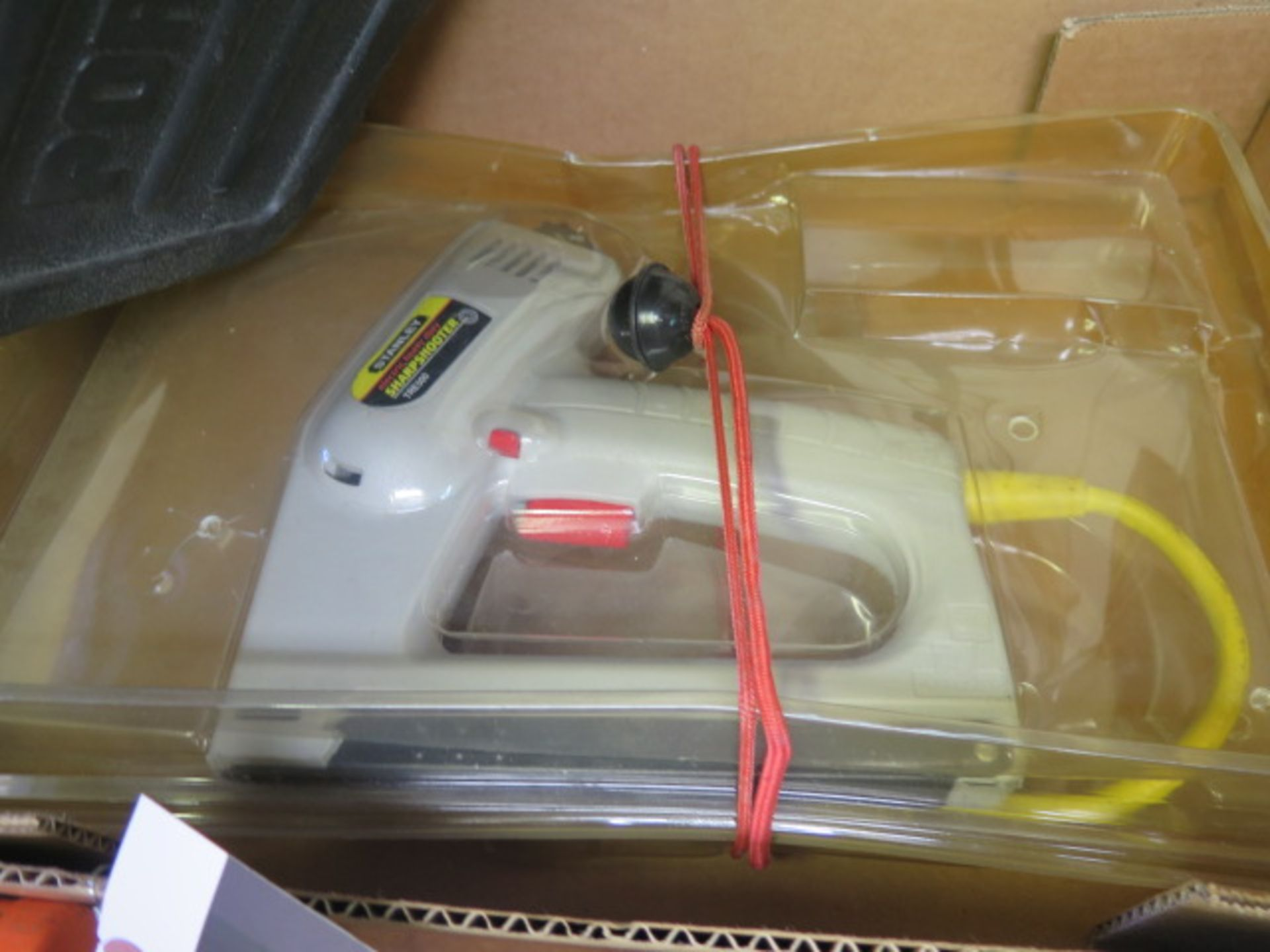 Lot 12 - Porter Cable Pneumatic Brad Nailer and Stanley Electric Stapler (SOLD AS-IS - NO WARRANTY)