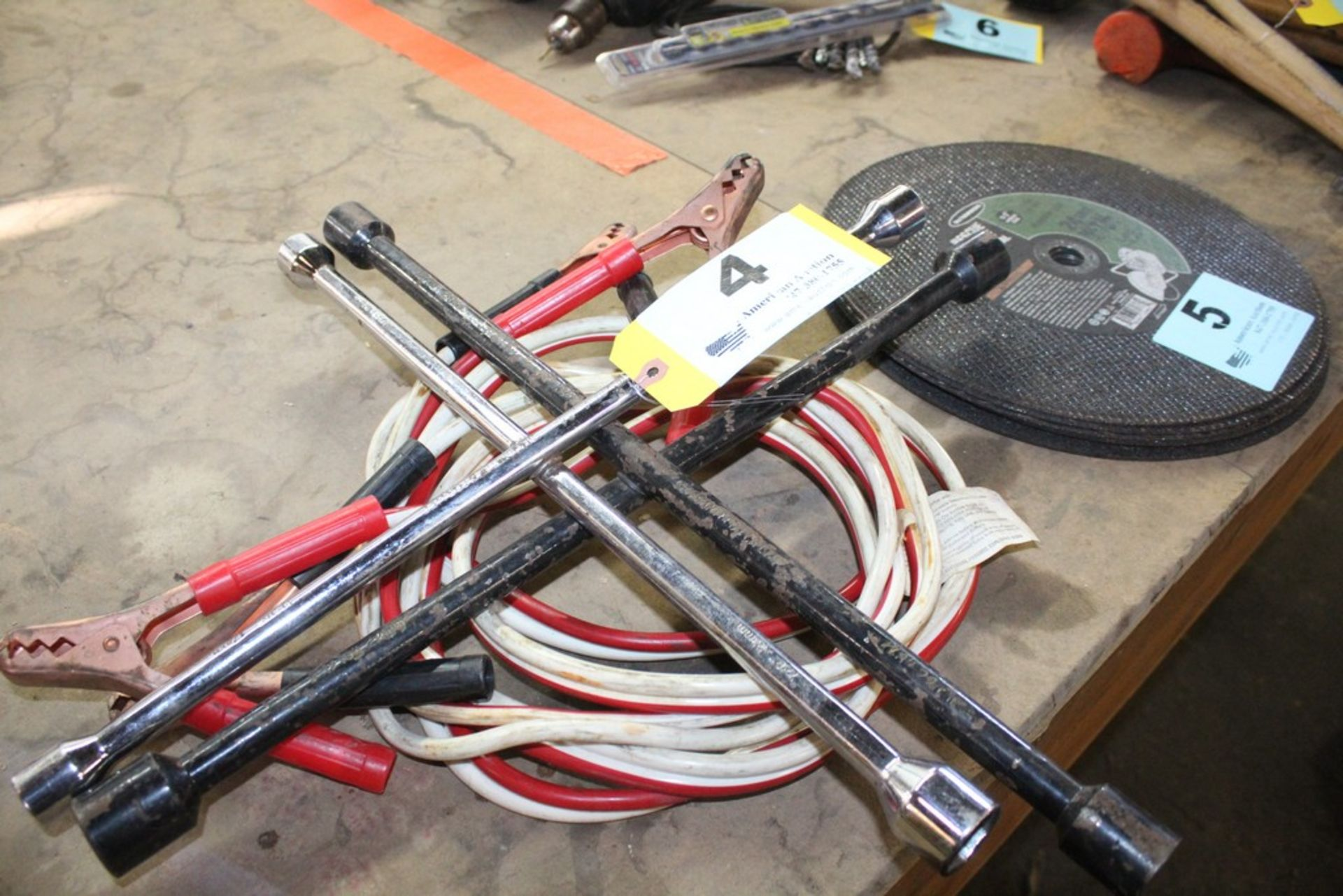 Lot 4 - FOUR WAY LUG WRENCHES AND JUMPER CABLES