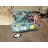 CURTIS PORTABLE ELECTRIC AIR COMPRESSOR (LOCATED AT 3201 S. 38TH ST. PHOENIX, AZ.)