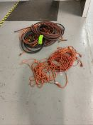 lot of Orange extension cords and air hose