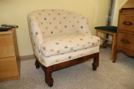 Beige checkered upholstered armchair