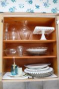 Everything pictured in cabinet, milk glass and glassware