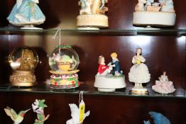Group: two snow globes, musical figurine, and two Dresden style ballerina figurines