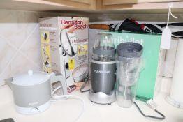 Nutri Bullet mixer, Hamilton Beach mixer, and Sylvania electric kettle