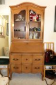 French Provincial style walnut secretaire bookcase, upper section fitted with two doors over fold do