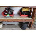 Contents of two shelves, miscellaneous go-kart engine parts, filters, and tires