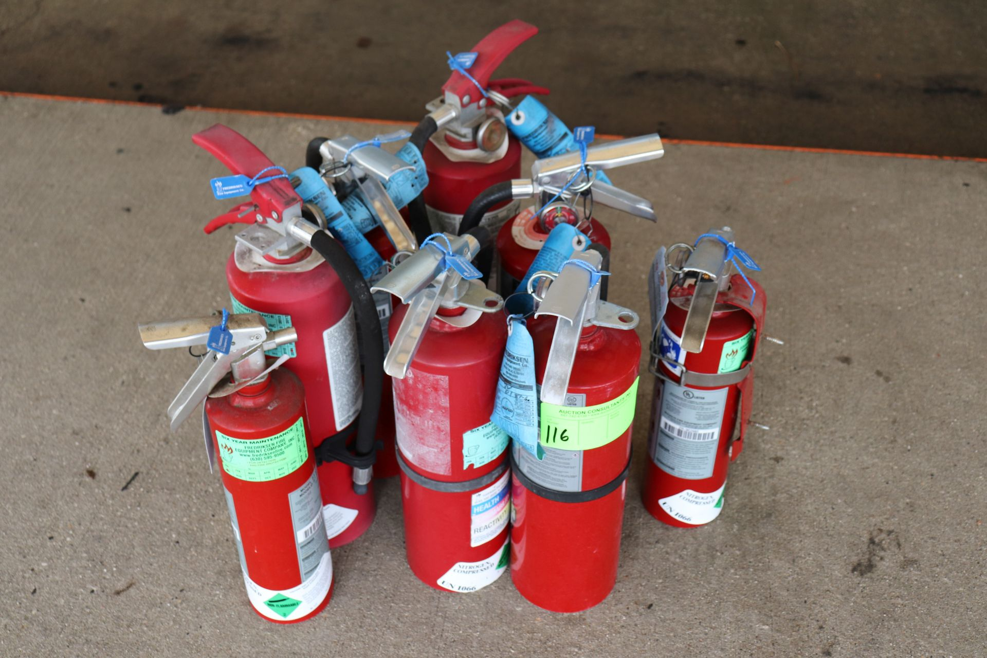 Lot of eight fire extinguishers, recently inspected