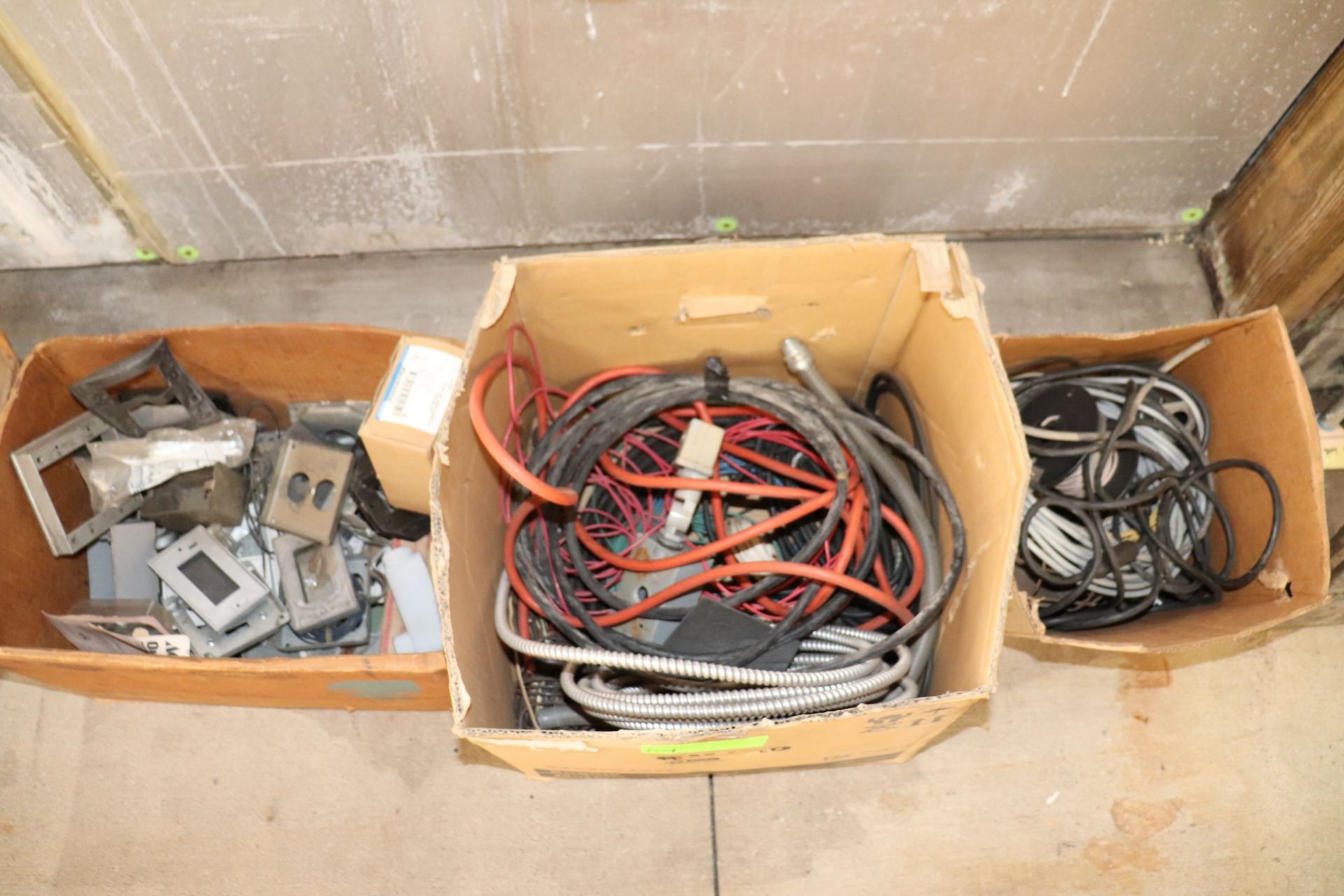 Three boxes of miscellaneous electrical supplies