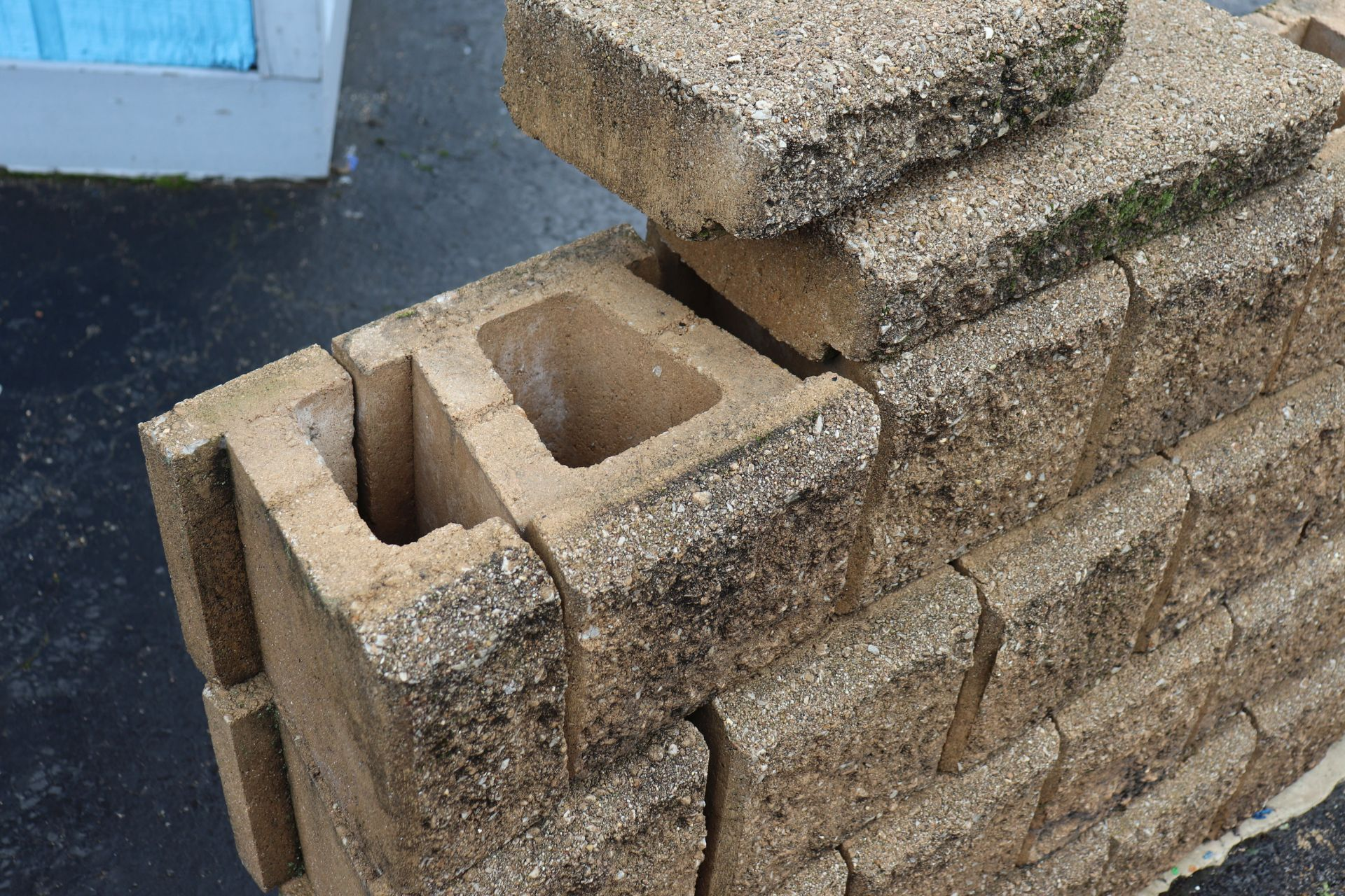 100 paver blocks with a quarter of total top blocks