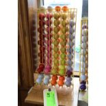 Rack of mini-golf golf balls