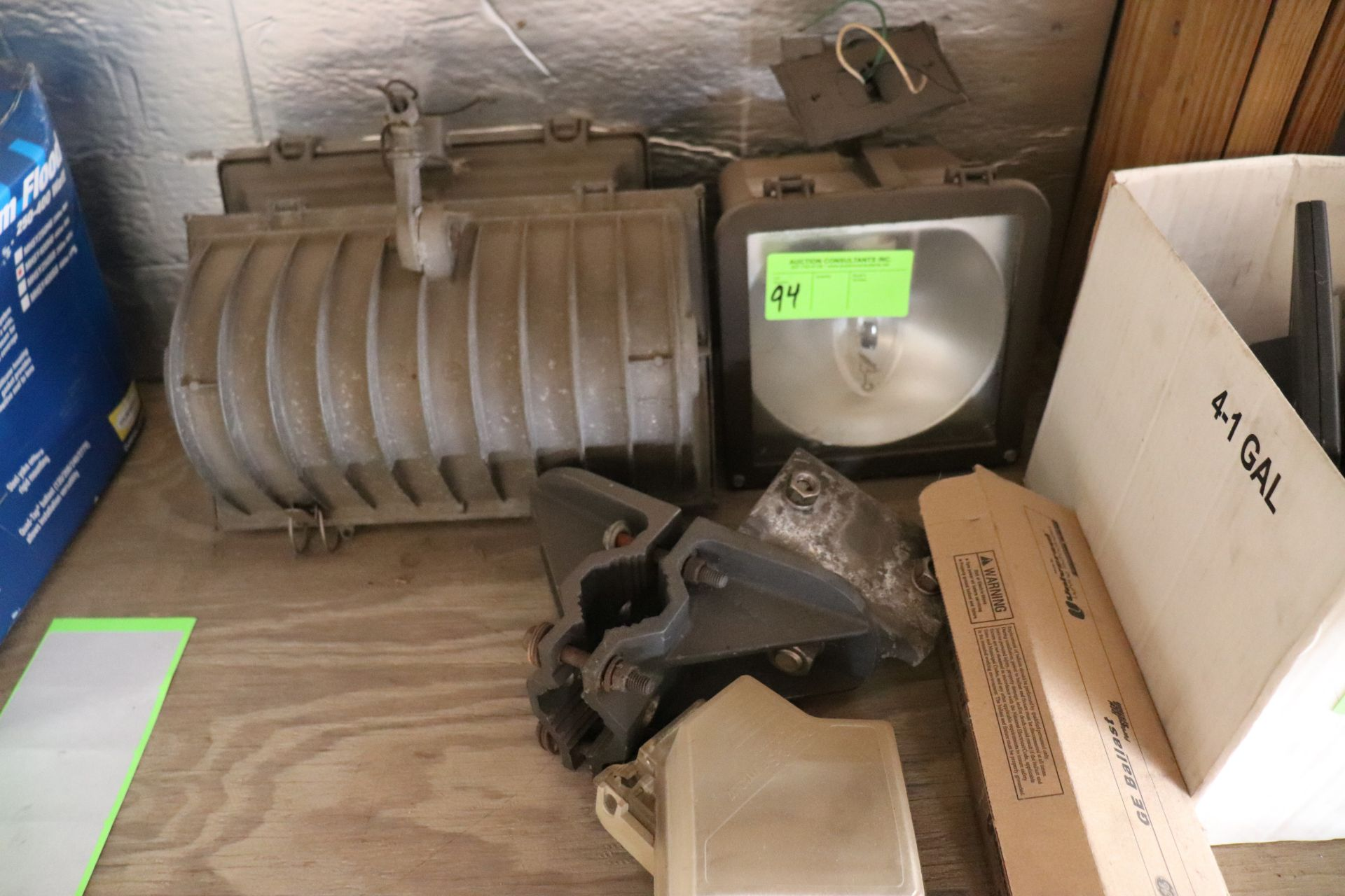 Three overhead light fixtures with mounting bracket and GE ballast