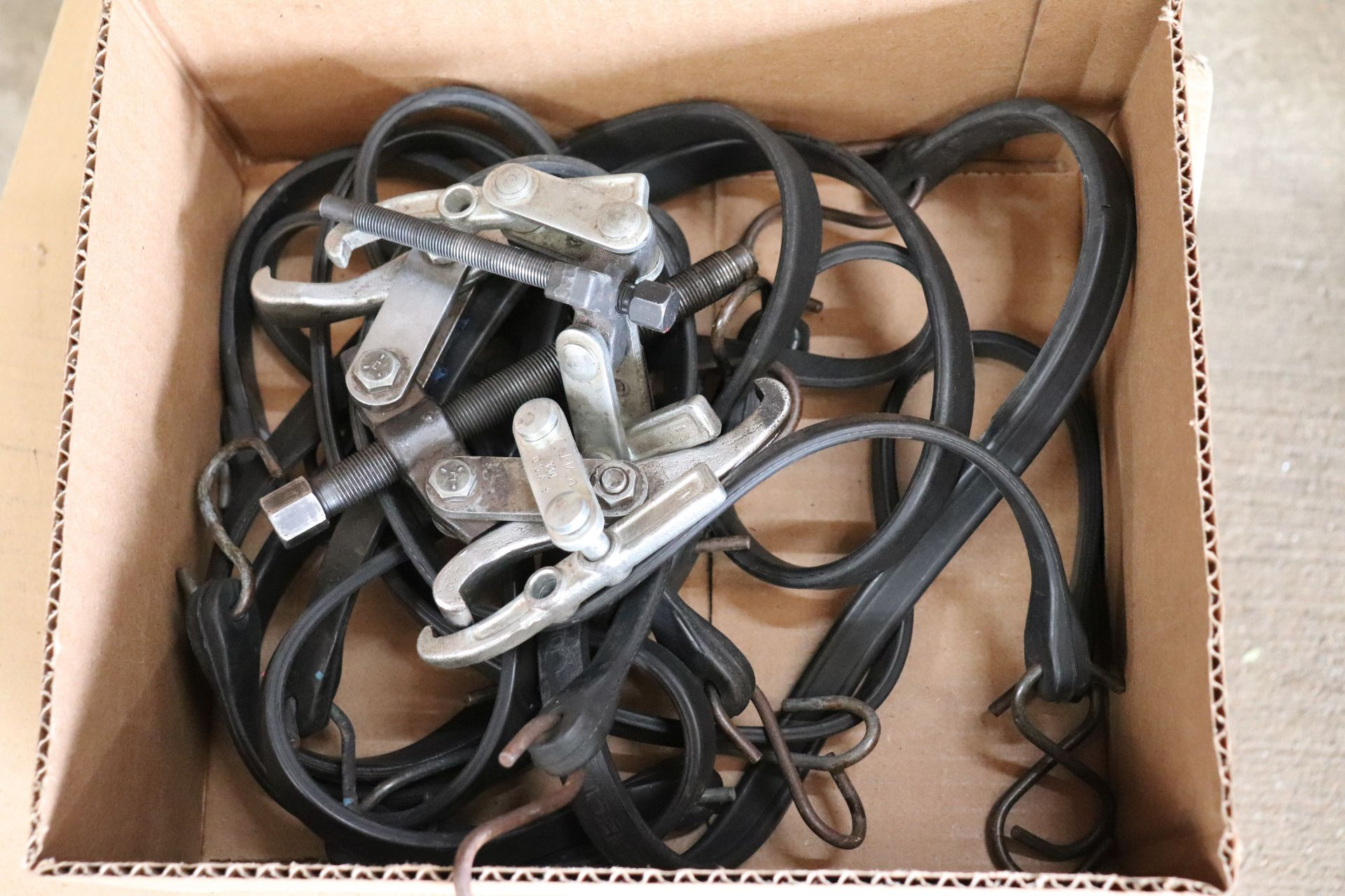 Lot of bungee cords and gear pullers