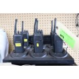 Six Motorola two-way radios with headsets