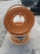 (2) 18X9 Backhoe Rim for a 12X16.5 tire with 8 Bolt Pattern.