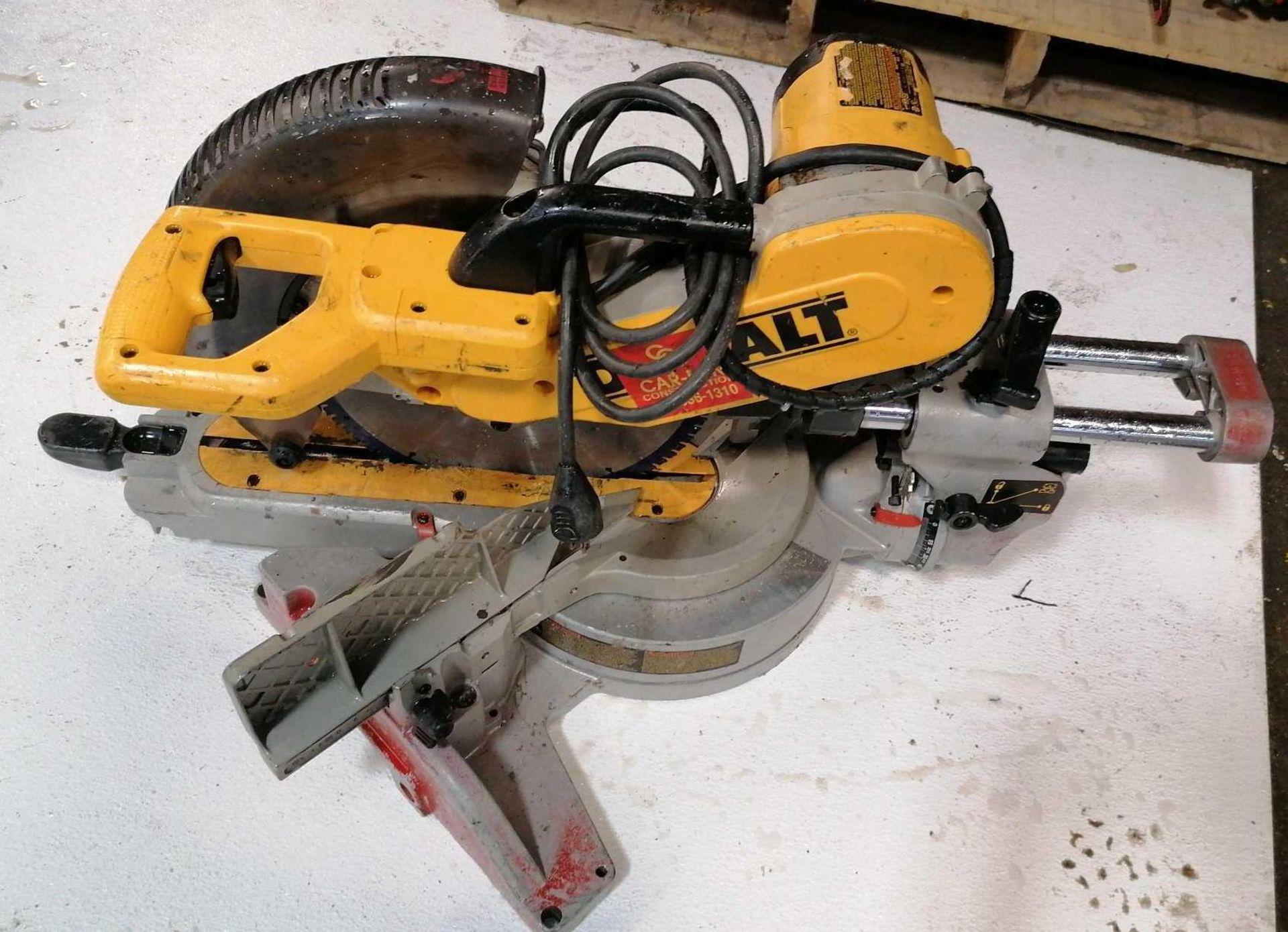 "Lot 14 - DeWalt DW718 12"" Compound Sliding Miter Saw"