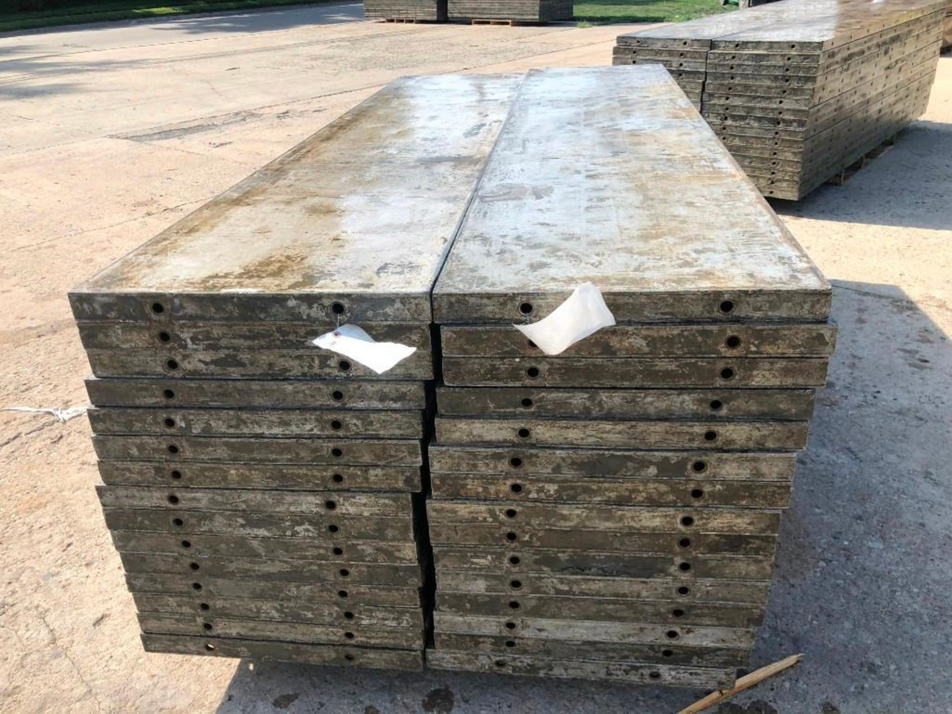 Lot 132 - (30) 2' x 9' Wall-Ties Aluminum Concrete Forms, Laydowns, Smooth 6-12 Hole Pattern. Located at 301 E