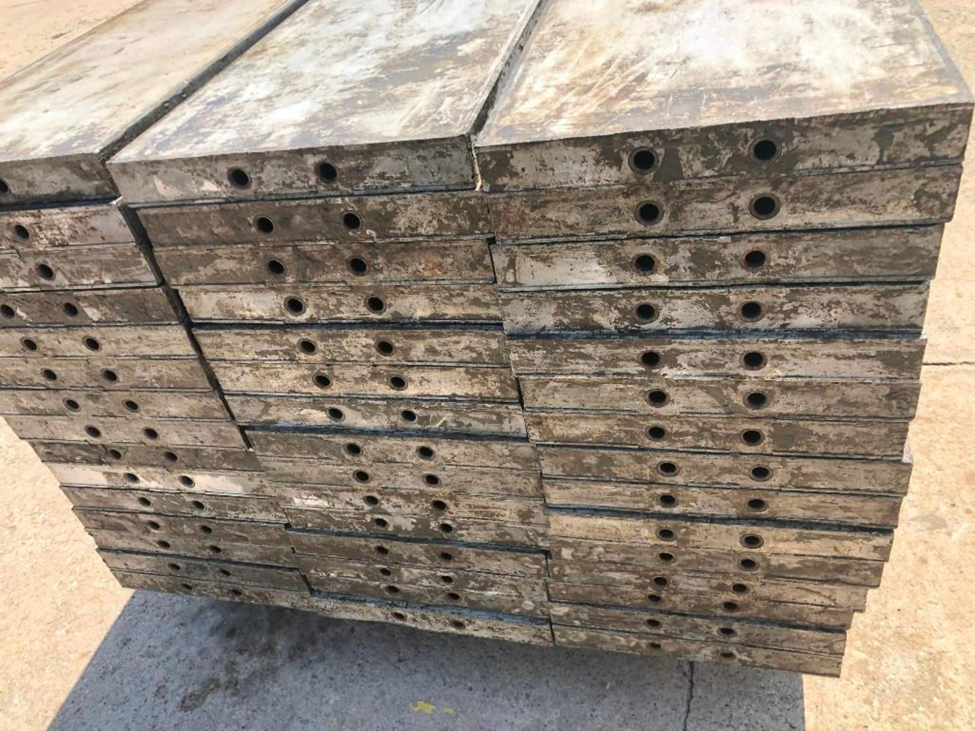 """Lot 155 - (15) 16"""" x 9' Wall-Ties Aluminum Concrete Forms, CAP, Smooth 6-12 Hole Pattern. Located at 301 E"""