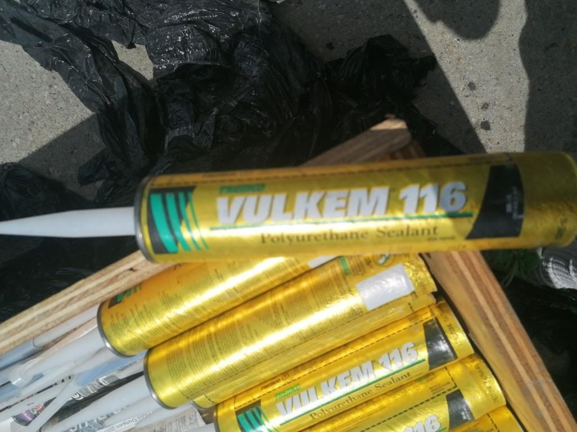 Lot 1036 - (87) Vulkem 116 Polyurethane Sealant. Located at 301 E Henry Street, Mt. Pleasant, IA 52641.