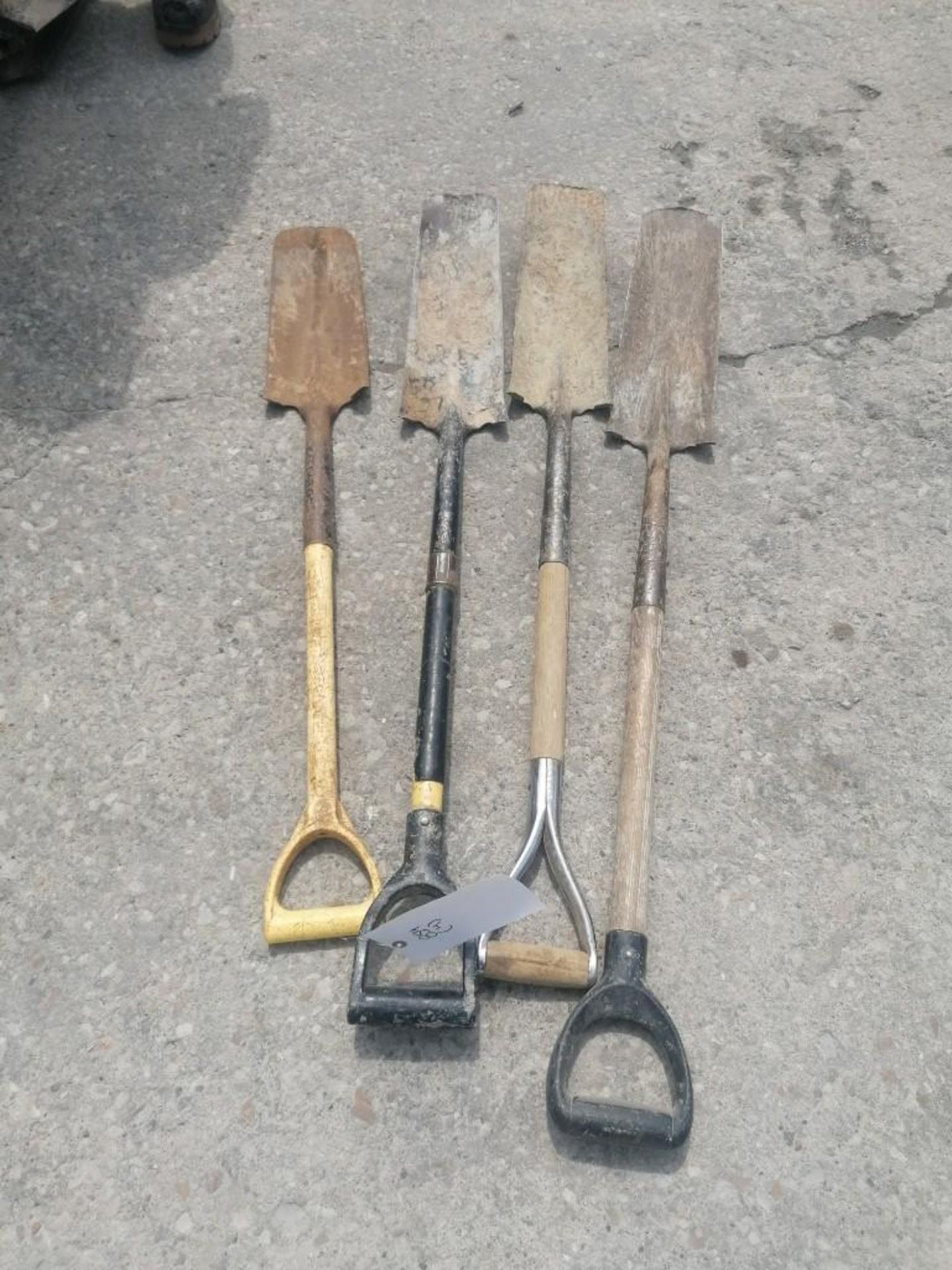 Lot 51 - (4) Shovels. Located at 301 E Henry Street, Mt. Pleasant, IA 52641.