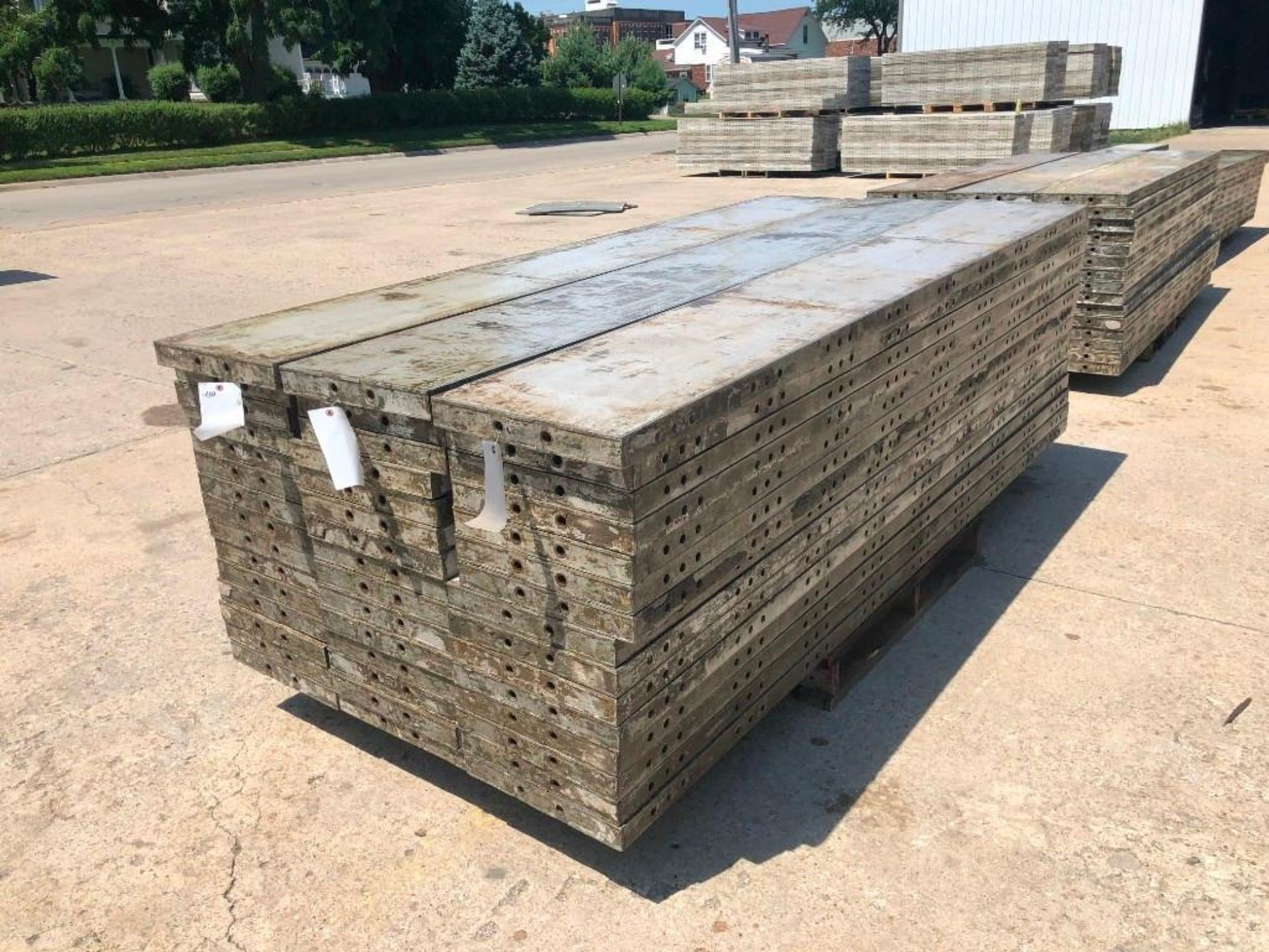"Lot 154 - (15) 16"" x 9' Wall-Ties Aluminum Concrete Forms, CAP, Smooth 6-12 Hole Pattern. Located at 301 E"