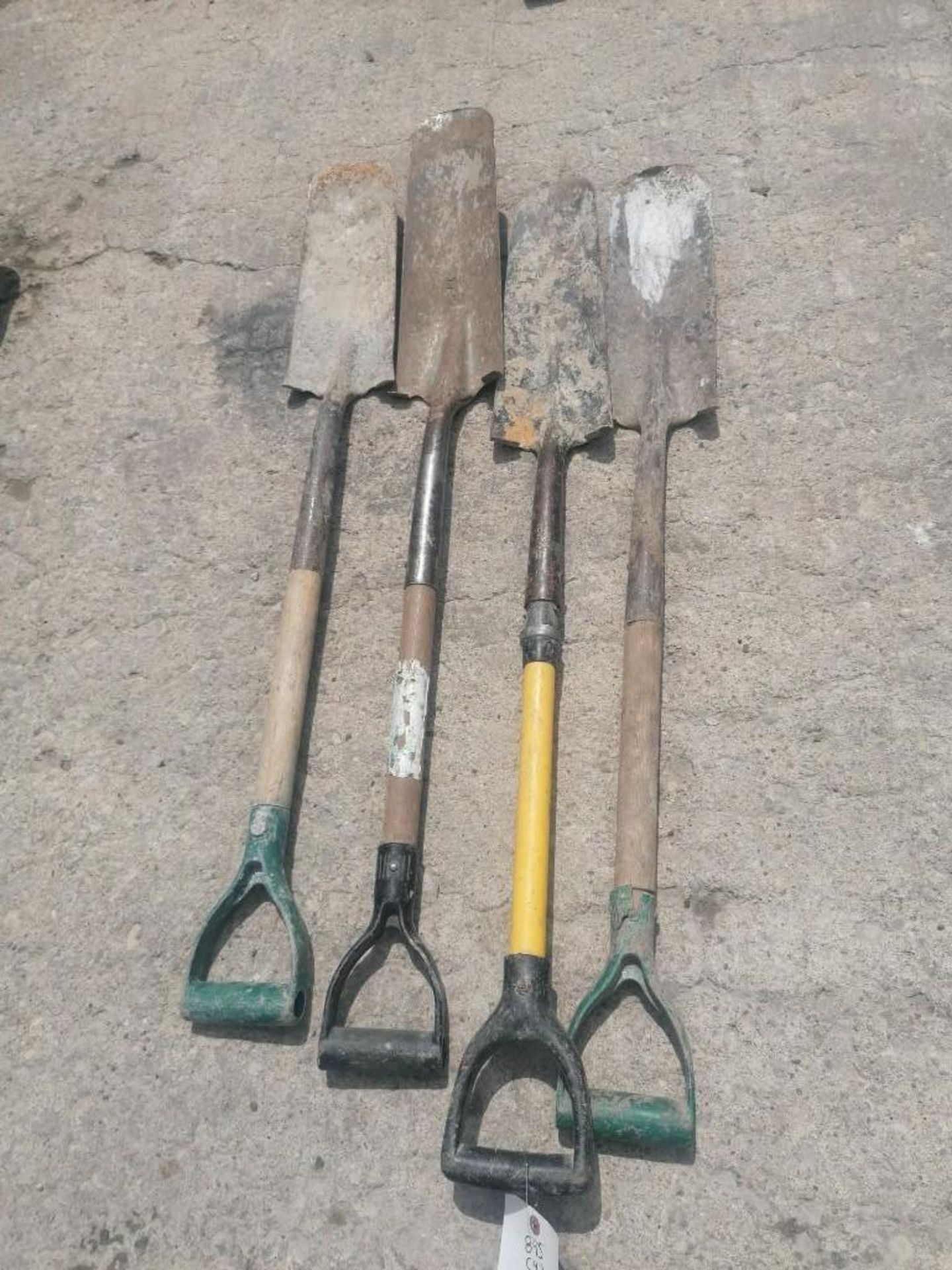 Lot 56 - (4) Shovels. Located at 301 E Henry Street, Mt. Pleasant, IA 52641.