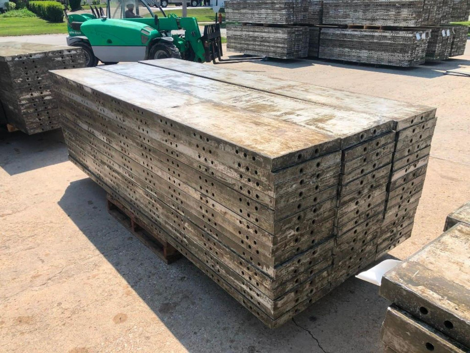 """Lot 157 - (15) 16"""" x 9' Wall-Ties Aluminum Concrete Forms, CAP, Smooth 6-12 Hole Pattern. Located at 301 E"""