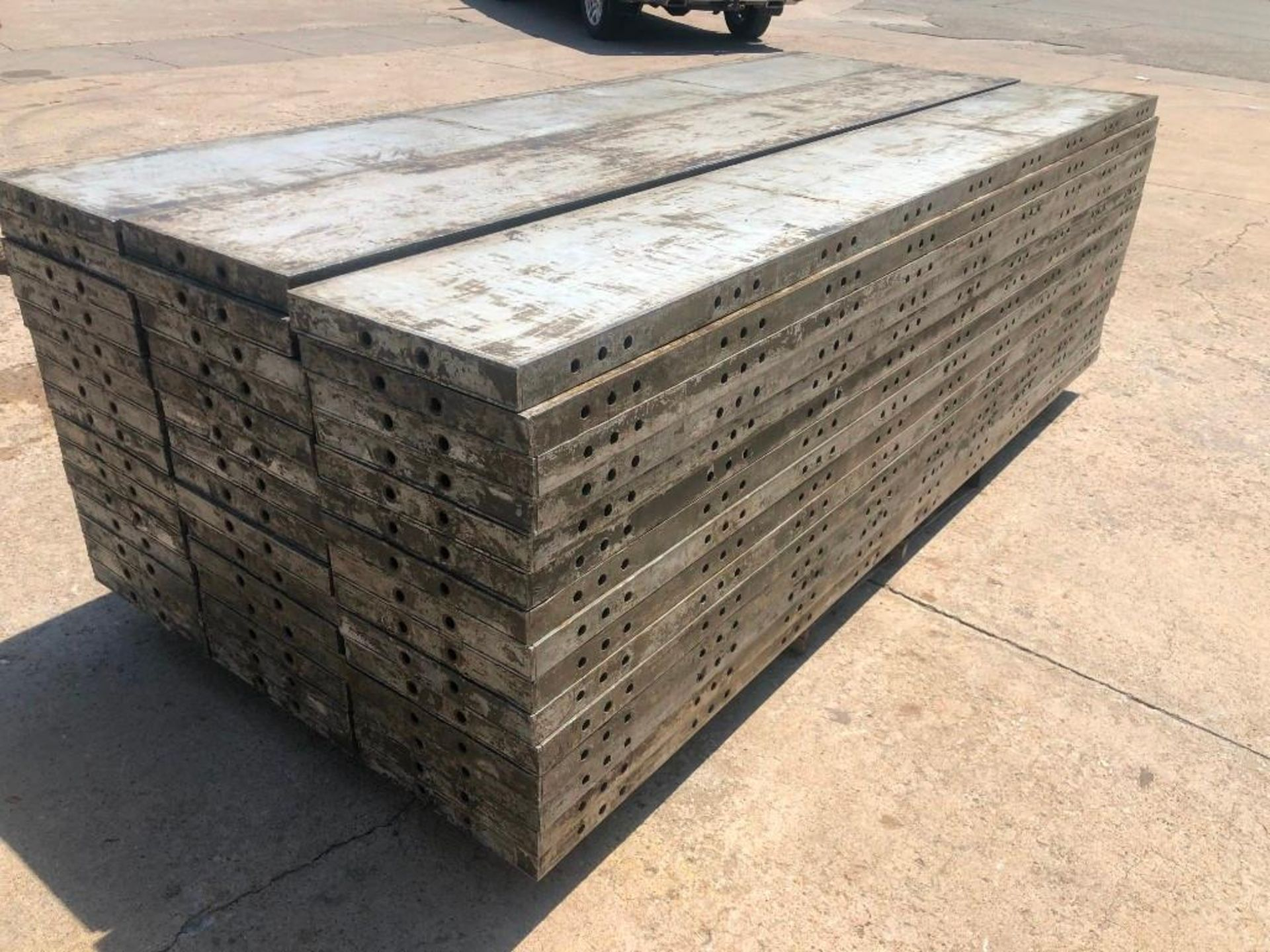 """Lot 161 - (15) 16"""" x 9' Wall-Ties Aluminum Concrete Forms, CAP, Smooth 6-12 Hole Pattern. Located at 301 E"""
