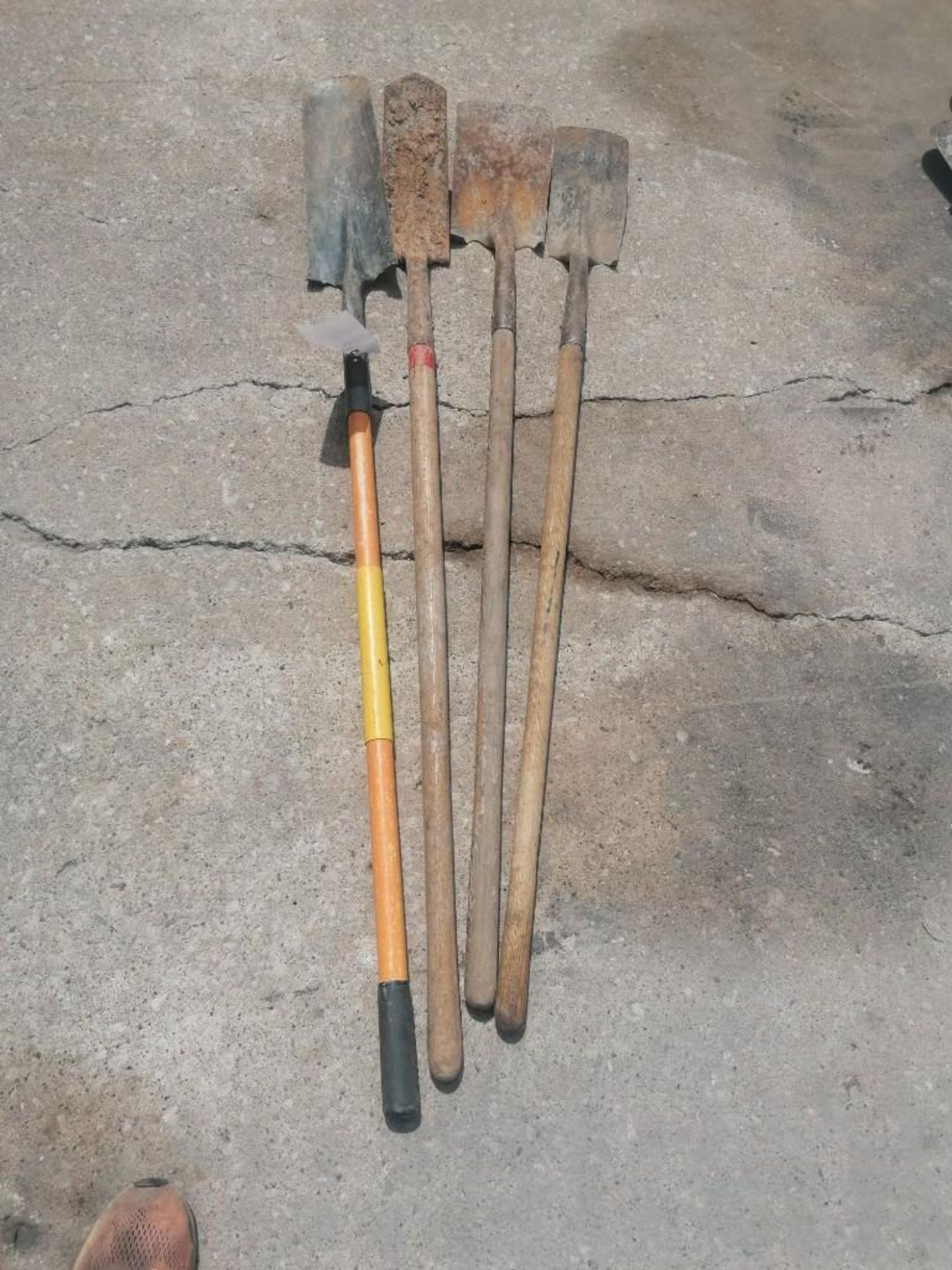 Lot 55 - (4) Shovels. Located at 301 E Henry Street, Mt. Pleasant, IA 52641.