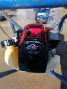 Shockwave Power Screed with Honda GX35 Motor. Serial #1145, 136.6 Hours. Located in Mt. Pleasant,