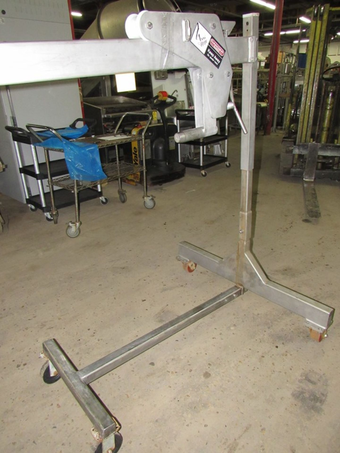 Lot 32 - Stainless Steel Auger Puller, 7' long, on wheels;*** All Funds Must Be Received By Friday, January