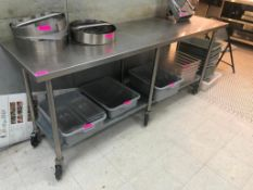 "DESCRIPTION: 7' X 24"" STAINLESS TABLE W/ GALVANIZED UNDER SHELF. ADDITIONAL INFORMATION: NO CONTENTS"