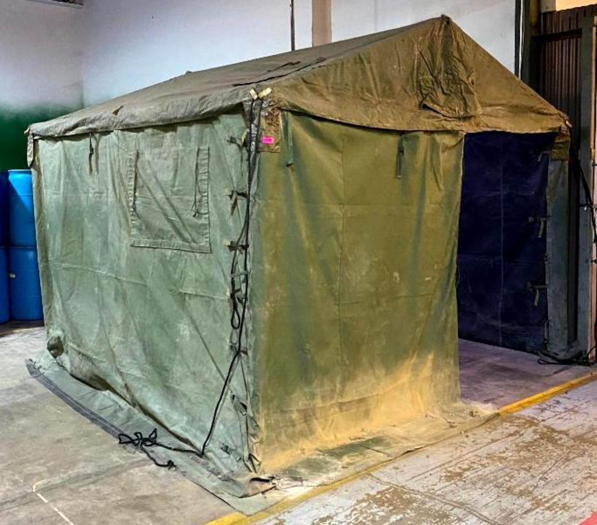 DESCRIPTION: MILITARY TENT WITH FRAME ADDITIONAL INFORMATION: HAD HOLES CUT IN CANOPY FOR SPRINKLER