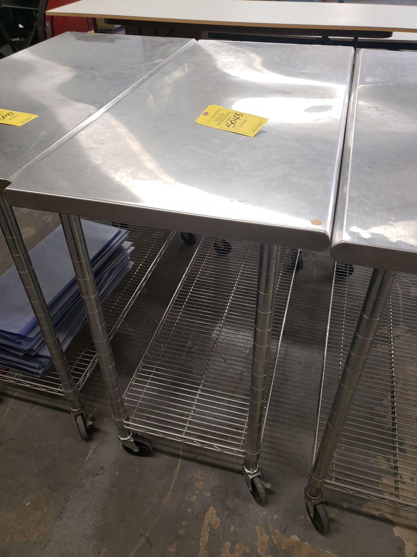 Lot 5048 - STAINLESS STEEL ROLLING TABLE (LOCATED AT: 16335 LIMA ROAD BLDG. 4 HUNTERTOWN, IN 46748)